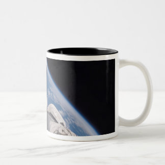 Space Shuttle Discovery backdropped by Earth Two-Tone Coffee Mug