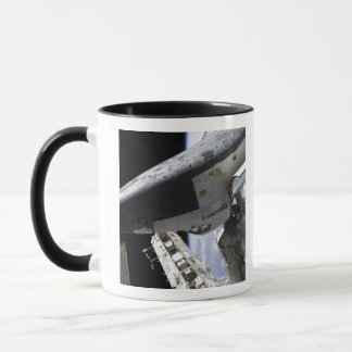 Space Shuttle Discovery docked Mug