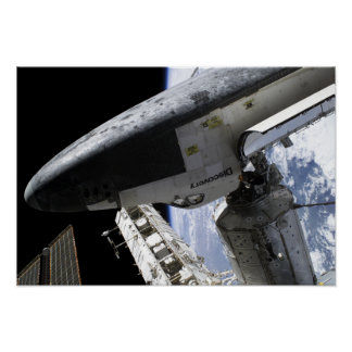 Space Shuttle Discovery docked Poster