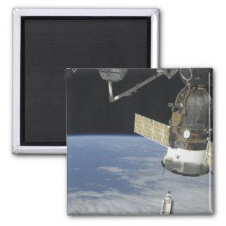 Space shuttle Endeavour, a Soyuz spacecraft Magnet