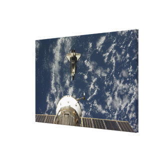 Space Shuttle Endeavour and a Soyuz spacecraft Canvas Print
