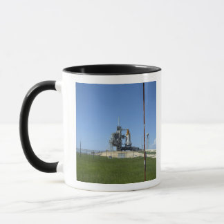 Space shuttle Endeavour is framed by a windsock Mug