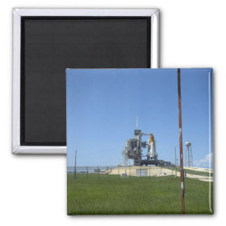 Space shuttle Endeavour is framed by a windsock Square Magnet