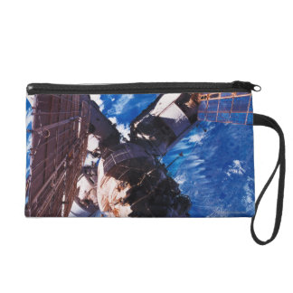 Space Station Orbiting Earth 5 Wristlet Purses