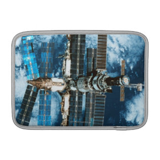 Space Station Orbiting Earth MacBook Sleeve
