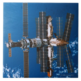 Space Station Orbiting in Space Large Square Tile