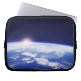 Space with rising sun above planet earth laptop sleeve