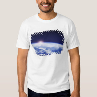 Space with rising sun above planet earth shirts