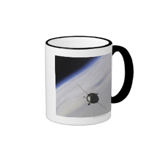 Spacecraft in outer space coffee mug