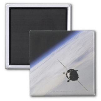 Spacecraft in outer space square magnet