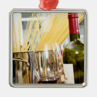 Spaghetti in pan with wine bottle and glasses christmas ornament