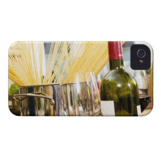 Spaghetti in pan with wine bottle and glasses iPhone 4 cases