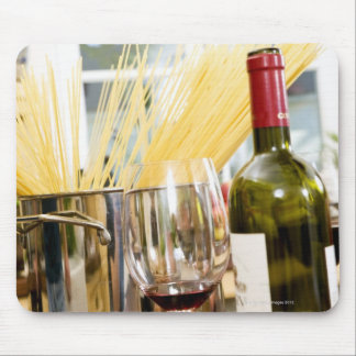 Spaghetti in pan with wine bottle and glasses mouse pad