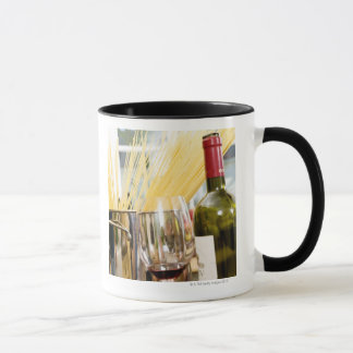 Spaghetti in pan with wine bottle and glasses mug