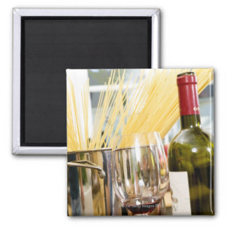 Spaghetti in pan with wine bottle and glasses square magnet