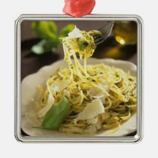 Spaghetti with basil and parmesan on plate, Silver-Colored square decoration