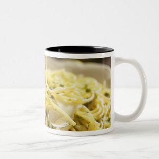 Spaghetti with basil and parmesan on plate, Two-Tone coffee mug