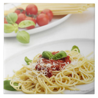 Spaghetti with tomato sauce and basil large square tile