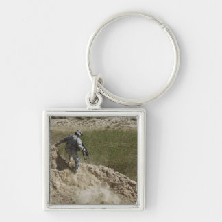 Specialist climbs down key ring