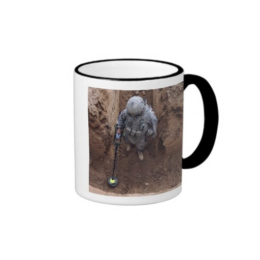 Specialist searches for a weapons cache coffee mugs