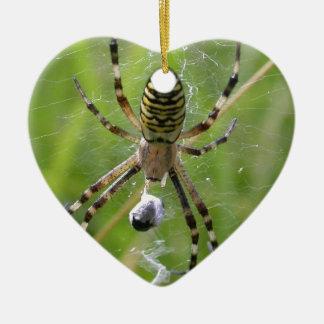 Spider with prey ceramic heart decoration