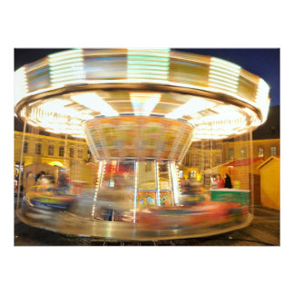 Spinning carousel at night announcements