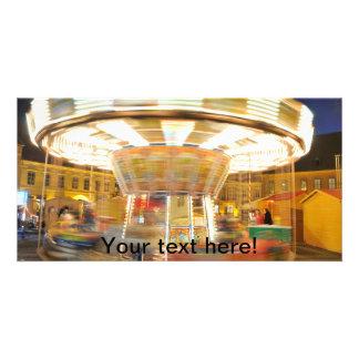 Spinning carousel at night photo card