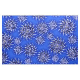 Spinning stars energetic pattern dark blue fabric