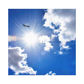 Spitfire WW2 Airplane flying past the sun. Canvas Print