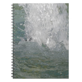 Splashes of fountain water in a sunny day spiral notebooks
