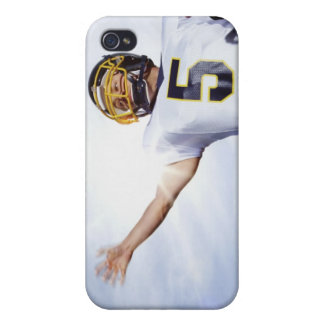 sportsman playing with rugby ball iPhone 4/4S cases