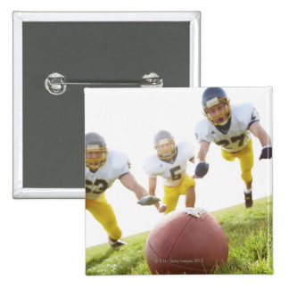 sportsmen playing with a rugby ball 15 cm square badge