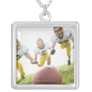 sportsmen playing with a rugby ball silver plated necklace