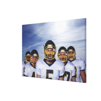 sportsmen standing together with sky in canvas print