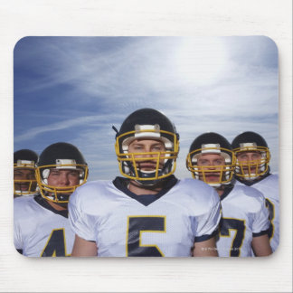 sportsmen standing together with sky in mouse mat