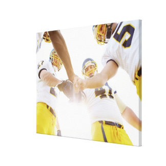 sportsmen standing with hands together gallery wrap canvas