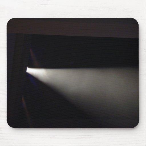 Spotlight against dark background mousepads