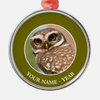 Spotted owl on morning flight. Silver-Colored round decoration