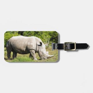 Spotting a Rhino feeding whilst on Safari Luggage Tag