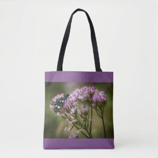 Spring butterfly on wildflowers tote bag