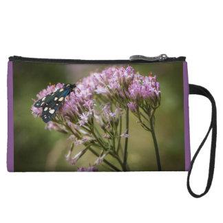 Spring butterfly on wildflowers wristlet purses