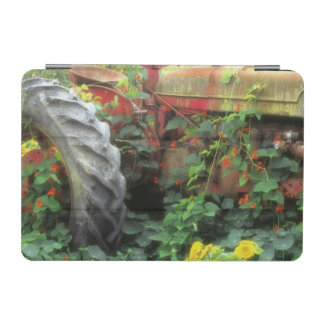 Spring flowers adorn an old tractor. iPad mini cover