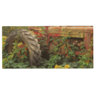 Spring flowers adorn an old tractor. wood USB 2.0 flash drive