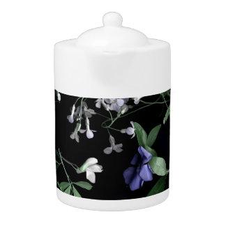 Spring flowers on black Teapot