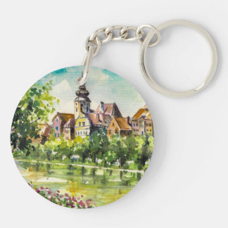 Spring in small city on the river key ring