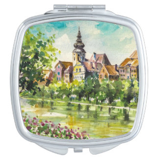 Spring in small city on the river travel mirror