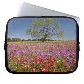Spring mesquite trees growing in wildflowers, laptop sleeve