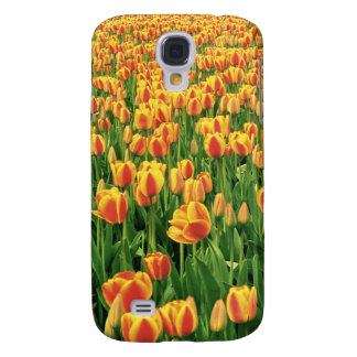Spring tulips bloom in front of old barn. galaxy s4 case