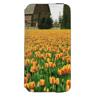 Spring tulips bloom in front of old barn. incipio watson™ iPhone 6 wallet case