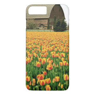 Spring tulips bloom in front of old barn. iPhone 8 plus/7 plus case
